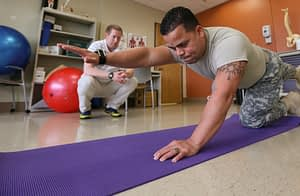 man having a workout session with his trainer