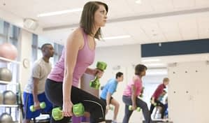 people having a workout session in a gym
