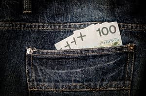 jeans pocket with money bills